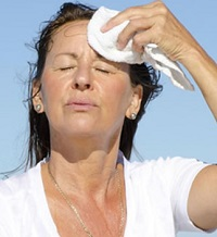 Sweating and dehydration can lead to electrolyte imbalance which can in turn cause muscle cramps